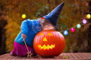 Child and pumpkin